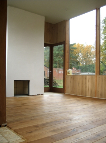 Fireplace and oak floor and oak wall (lambrise)
