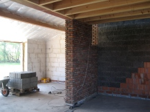 Inside walls are plastered, brick or argex blocks for different textures