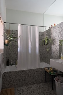 Bathroom receiving daylight from east and west