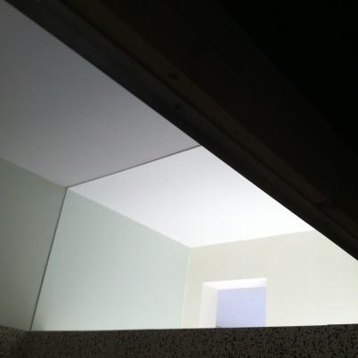 Window separating vestibule and bathroom