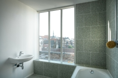 Top floor bathroom with view of the cityscape