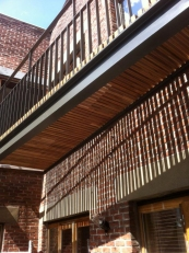 Terrace seen from below, two centimeter spaces between the beams allow for the sun to come through